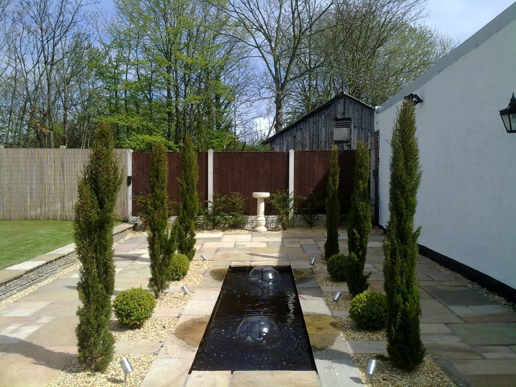 Rill with planting of Yew and cypress